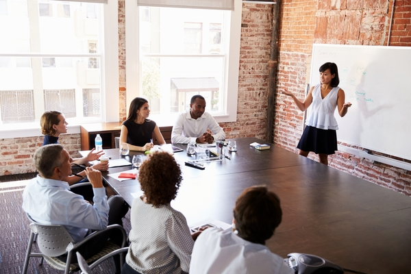 A facilitator explains what the team can expect from their sales training